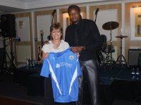 Janie Bailey with Stockport County Footballer Mansour Assoumani